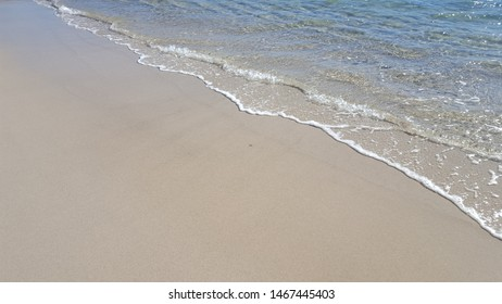Background for travel and tourism. seaside with sand and blue water on a sunny day