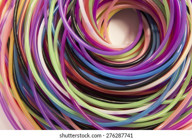 Background of twisted spiral colored lines. Abstract