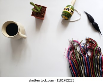 background with typical mexican objects, hot coffee cup, whiskers, cactus in a flowerpot, balero and rebozo