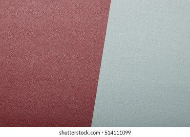 Background of unusual modern material design. Color paper cardboard cards. background of bright colorful paper. Copy space. Gray and red paper.