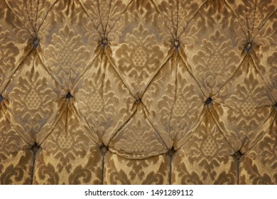 Background with upholstery of worn vintage armchair