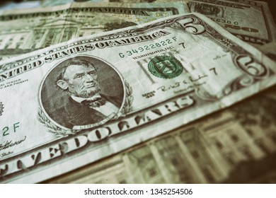 Background of used dollars banknotes. Shallow depth of field.