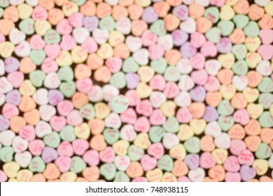 Background of Valentine conversation heart candy featuring #Love