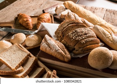 Background of variety mixed homemade organic fresh bake pastry ( sliced bread, toast, loaf, Croissant and baguette ). Best for delicious healthy vegetarian meal