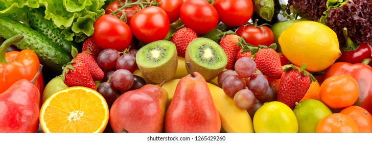 Background from variety natural delicious fruits and vegetables.