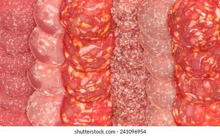 Background -variety of sliced salami.