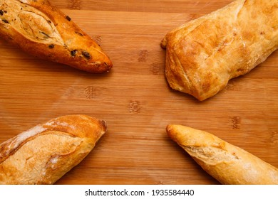 BACKGROUND OF VARIOUS BREADS, CIABATTA, FRENCH BAGUETTE, BLACK OLIVE BREAD and GRATINATED BAGUETTE
