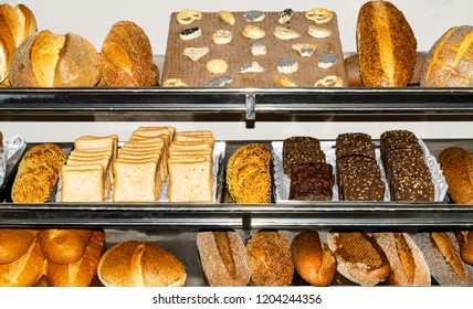 background with various types of fresh bread with wheat, seeds, grains, poppy
