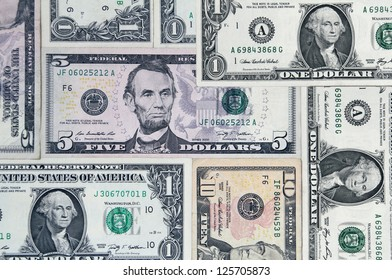 Background of various US dollar bills.