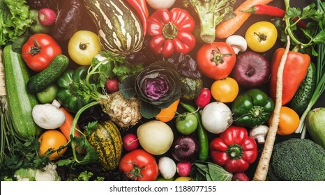Background of vegetables different fresh farm vegetables. Food or Healthy diet concept, top view and light effects