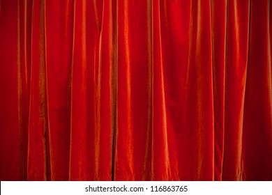 background of velvet red theater curtain closed