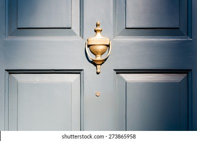 Background of vintage blue painted door and knocker vignette look