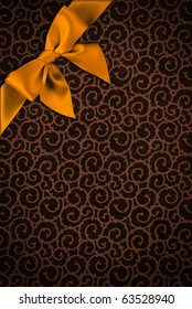 Background of vintage decorative wrapping paper with a golden bow