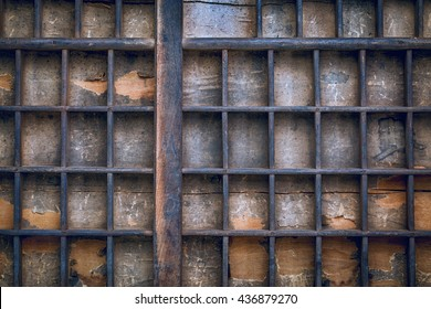 background of vintage grunge wood typesetter drawer with dividers