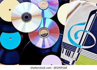 Background with Vinyl record discs ans CD. Top view