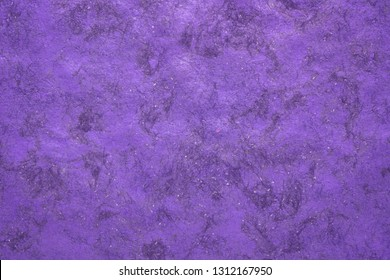 background of  violet Huun Mayan handmade paper created  by Mayan artisans throughout the Yucatan Peninsula of Mexico