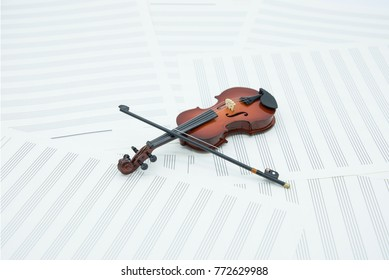 The background of the violin and  music paper.