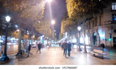 Background with walking blurred people outdoors in the evening lights