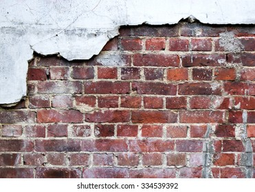 Background/ wallpaper - brick wall with crumbling plaster.