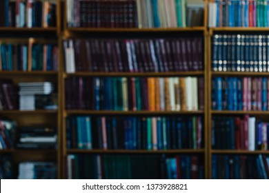 Background for wallpaper in the form of a defocused bookshelf.