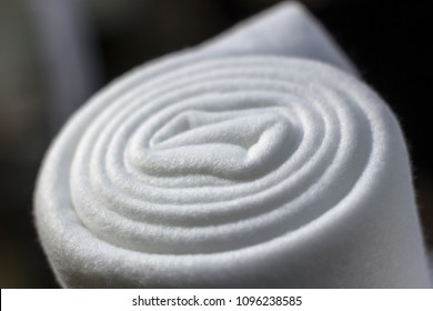 Background of warm twisted thick blankets. Stack of woolen checked blankets. The cosiness and comfort in the cold winter