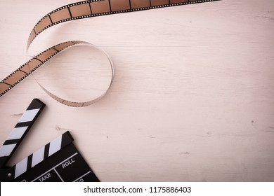 Background of watching movies with objects on the left with a wooden background. Horizontal composition. Top view.
