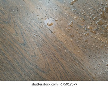 Background of water drops on the wooden floor