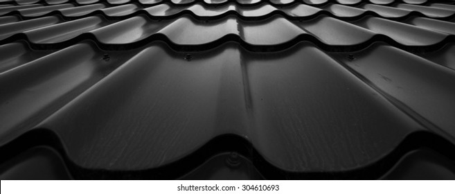 Background of wavy metallic tiles for roofing.