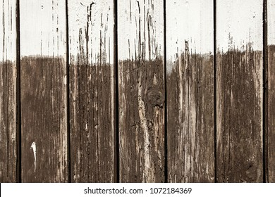 Background, weathered wooden fence with unfinished white painting, copyspace
