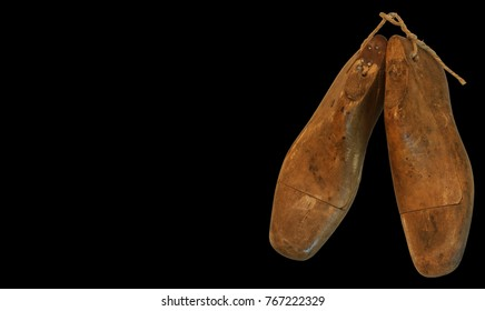 Background whit an old pair of shoe Lasts (foot shaped forms used to make shoes)