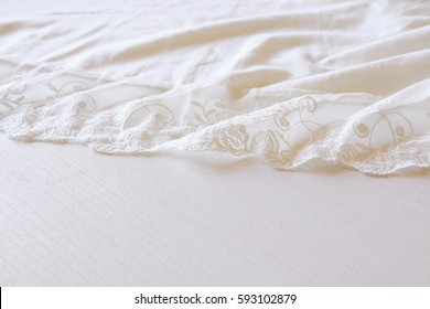 Background of white delicate lace fabric.