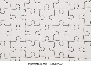 background of white jigsaw puzzle
