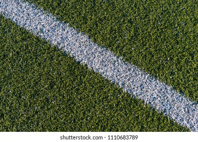Background from a white line on a green artificial soccer field