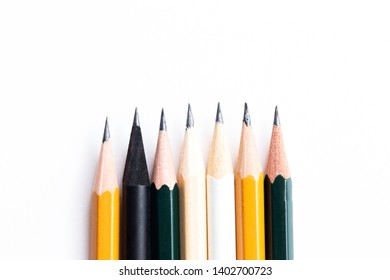 Background with white paper and pencils. Workplace for the artist and illustrator. Background to display the logo and lettering. copyspace, space for text. Office tools.