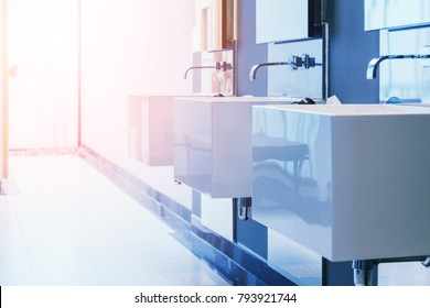 background of white restroom with marble finishing luxury restroom design concept