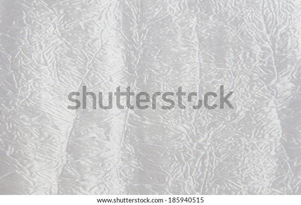 the background of white shiny textile