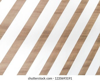 The background of white strip on wooden board
