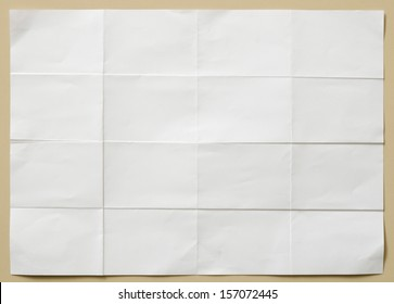 background of white textured sheet of paper folded in sixteen  part for write