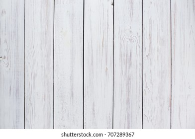 The background is white. Wooden background.
