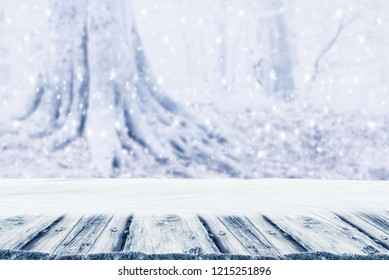 Background winter forest trees with snow und empty wooden board. Winter Christmas concept.