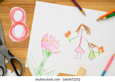 Background for Women's Day. Greeting card international women's day March 8. Children's drawing, colored pencils lie on the table. Number 8 cut from paper on background. Cut from paper. creativity