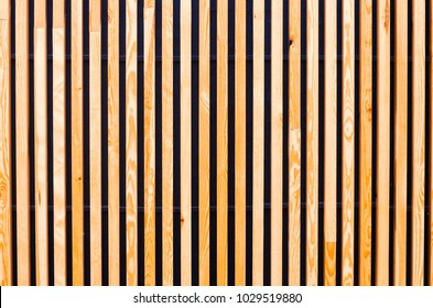 background of wooden boards, slats. Modern architecture, urban. Wooden texture. Designer background