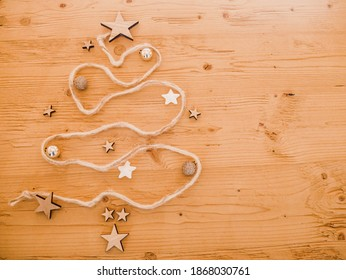 background wooden Christmas tree and stars