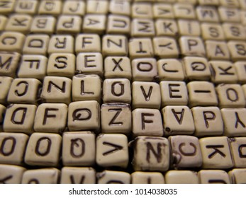 Background of wooden cubes with the letters forming the words Love.