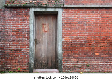 background of wooden gate in old brick wall in historic district of taipai