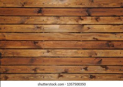 Background of wooden lacquered boards connected together by self-tapping screws