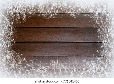 Background of wooden planks in the snow. Winter motif. Brown and white colors.