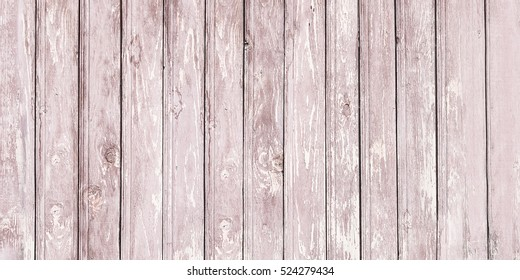 Background of wooden red old fence texture.