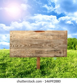 background  of wooden space for text and green landscape