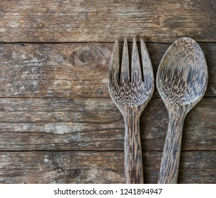 Background of a wooden spoon and fork on wooden floors.